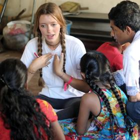 Youth Development volunteer teaches her students how to pronounce English words correctly in Sri Lanka.